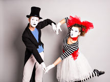 Two mimes shows the heart. Pantomime heart, love concept, April Fools Day concept.  royalty free stock images