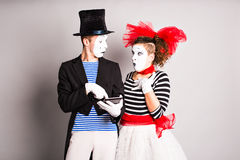 Two mimes use of tablet,  April Fools Day concept Royalty Free Stock Photo