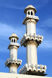 Two minarets. Two arabic minarets and blue sky in Bahrein Royalty Free Stock Photo