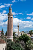 Two minarets in Antalya. Mosque by the sea in Antalya (Turkey Royalty Free Stock Photos