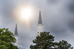 Two minarets of a berlin mosque. With the sun in background Stock Photography