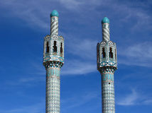 Two minarets on blue sky background, Iran.  Royalty Free Stock Images