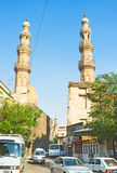 Two minarets. CAIRO, EGYPT - OCTOBER 9, 2014: The narrow Sheikhoun street runs between two medieval mosques, on October 9 in Cairo Royalty Free Stock Photography
