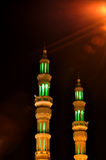 Two minarets in the night in United Arab Emirates. Two minarets of Mosque in the night in Ajman. United Arab Emirates Royalty Free Stock Photo