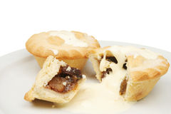 Two mince pies and cream Royalty Free Stock Images