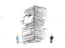 Two mini figure businessman with sketchy stack of papers or repo. Photo two mini figure businessman with sketchy stack of papers or report at white background Royalty Free Stock Images