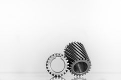 Two mini gear spiral teeth on isolated. Background Royalty Free Stock Image