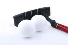 Two mini golf balls and club Stock Photography