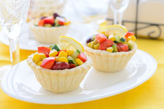 Two mini tarts with salad from sweet corn, kidney beans and avocado salad on festive table Royalty Free Stock Image