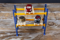 Two miniature cars and some coins Royalty Free Stock Photography