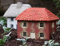 Two Miniature Houses Is A Garden Stock Image
