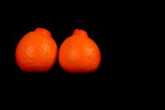 Two minneola oranges. Isolated on black Stock Photo