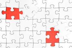 Two Missing Jigsaw Pieces. Blank puzzle with two pieces missing Stock Images