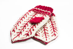 Two mitten on white. Two knitted woolen mitten isolated on white Royalty Free Stock Photo