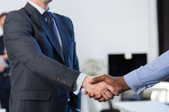 Two Mix Race Unrecognizable Business Man Shake Hand Agreement Coworking Center Business Team Coworkers Royalty Free Stock Photos