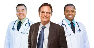 Two Mixed Race Doctors Behind Businessman Isolated on White stock photos