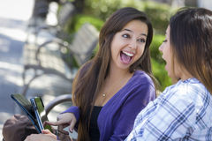 Two Mixed Race Students Using Touch Pad Computer Outside Stock Photography