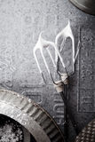 Two mixer whisks and baking pan details on metallic background Stock Photography