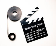 Two 35mm movie reels and clapperboard in vintage color effect Stock Photography