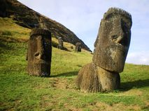 Two Moai. Photo of two moai (the ancient statues of Easter Island or Rapa Nui) with the quarry in the background Stock Image