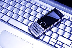 Two mobile devices. Blue tint. Royalty Free Stock Images