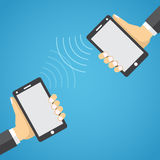 Two mobile devices connected together. Stock Photography