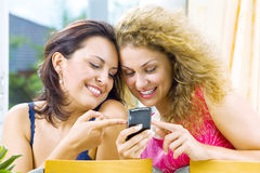 Two and mobile phone Royalty Free Stock Image