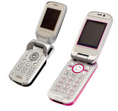 Two Mobile Phones. Two mobile flip phones open and isolated on a white background royalty free stock images