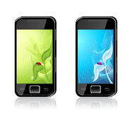 Two mobile phones with  ladybird on leaf  Backgrou Stock Photos
