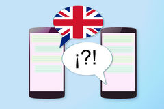 Two mobiles in a chat communication in English and other language. Empty copy space Royalty Free Stock Photos