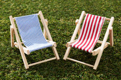 Two Model Deckchairs On Grass Royalty Free Stock Images
