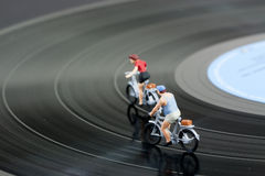 Two model people in cycle race Royalty Free Stock Photos