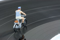 Two model people in cycle race Royalty Free Stock Images