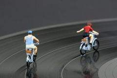 Two model people in cycle race Stock Photography