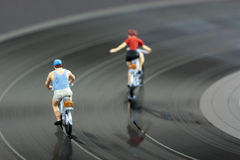 Two model people in cycle race Royalty Free Stock Photography