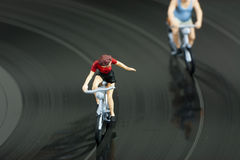 Two model people in cycle race Royalty Free Stock Image