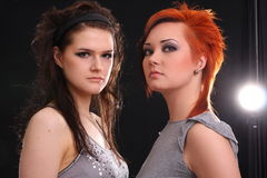 Two models in colorful setting in the studio Stock Photo