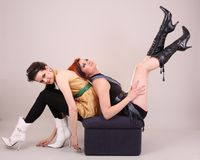Two models in colorful setting in the studio Royalty Free Stock Photo