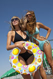 Two models with multicolored inflatable ring Stock Image