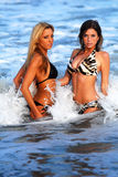 Two Models in the ocean. Two models pose in the ocean Stock Photo