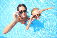 Two models in a pool Stock Images