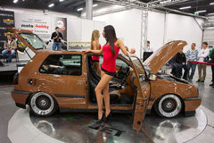 Two models and VW Golf Stock Images