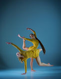 The two modern ballet dancers. Dancing on gray background Royalty Free Stock Image