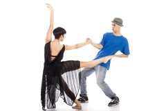 Two modern ballet dancers in dynamic action figure, on white bac. A couple of two young, attractive, modern ballet dancers, one women and one man,  in dynamic Stock Image