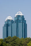 Two Modern Blue Office Towers Rising From Trees Stock Photos