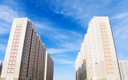 Two modern buildings on blue sky background Royalty Free Stock Photography