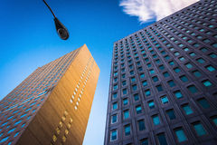 Two modern buildings and a streetlamp in Baltimore, Maryland. Royalty Free Stock Image