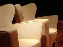 Two Modern Chairs. Two chairs in moody lighting royalty free stock images