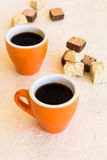 Two modern coffee cups with halva and waffles Royalty Free Stock Images