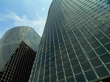 Two modern commercial buildings. Two high-rise geometric glass and metal structure commercial buildings upward view Stock Image